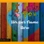 Write His/Her name on colorful heart on wood wall